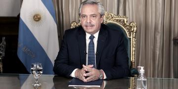 el presidente firmo el decreto para convertir los planes sociales en empleo genuino